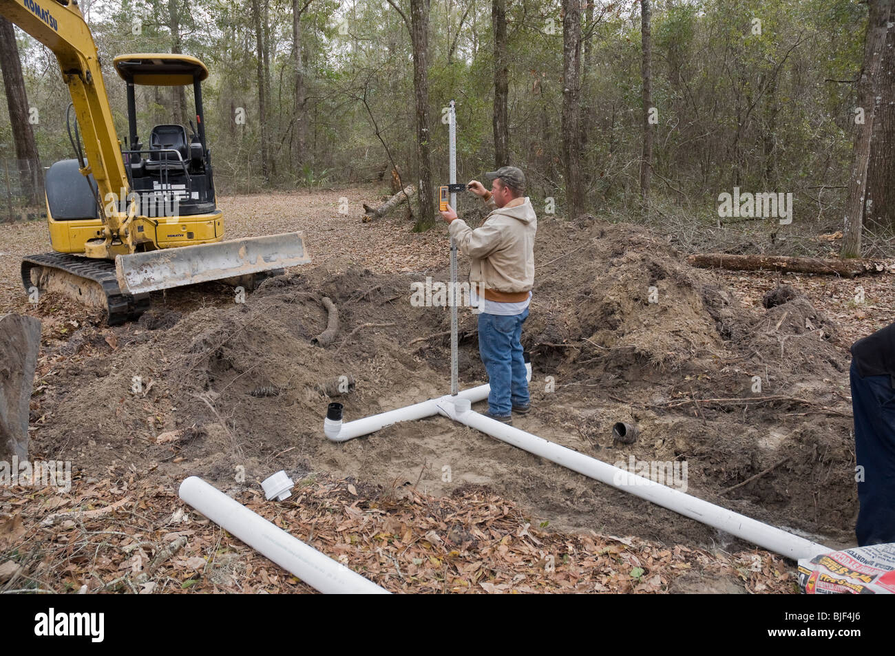Installing New Septic System Drainfield Checking Level