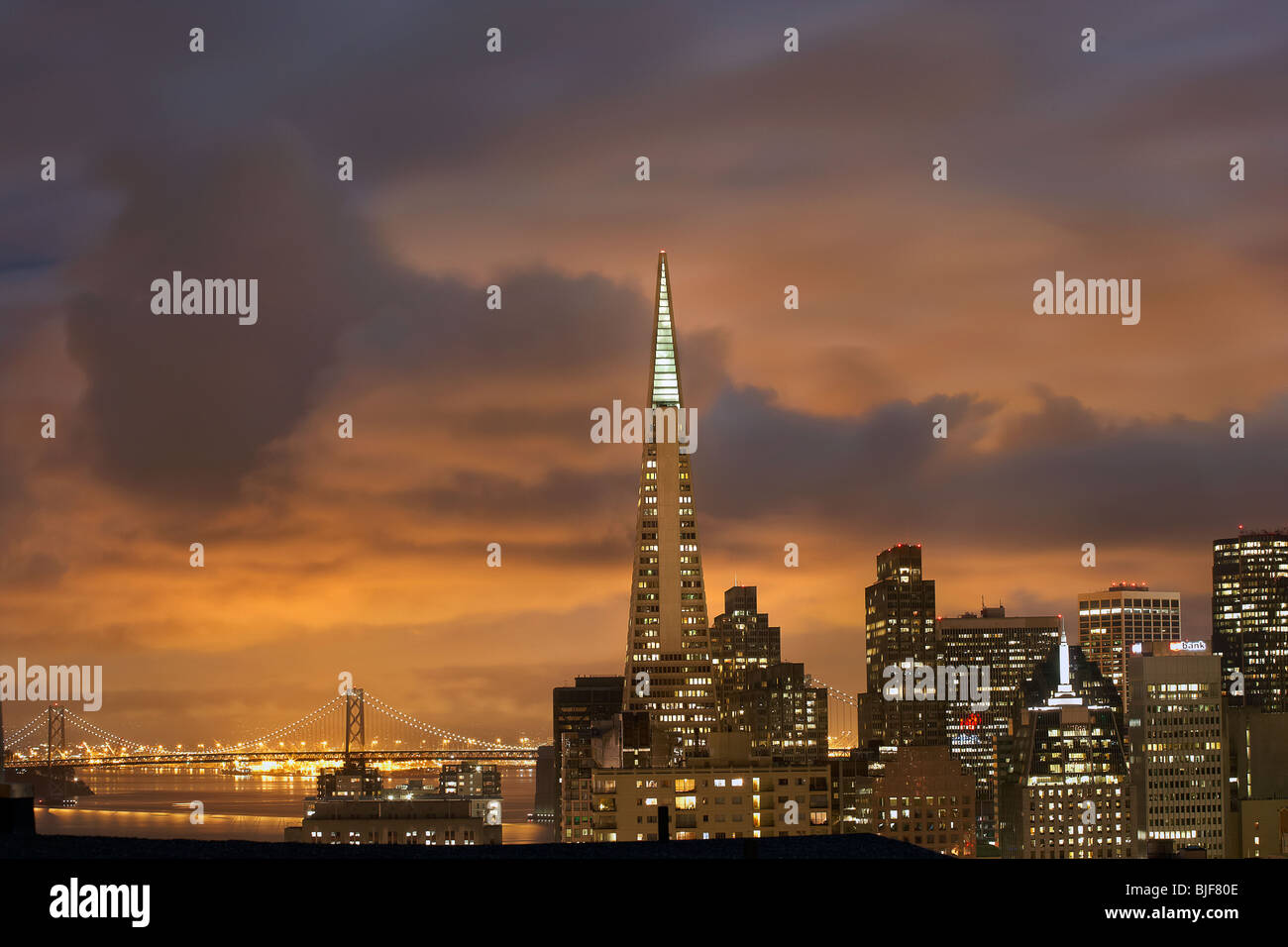 City scape of San Francisco at night with heavy clouds. - Stock Image