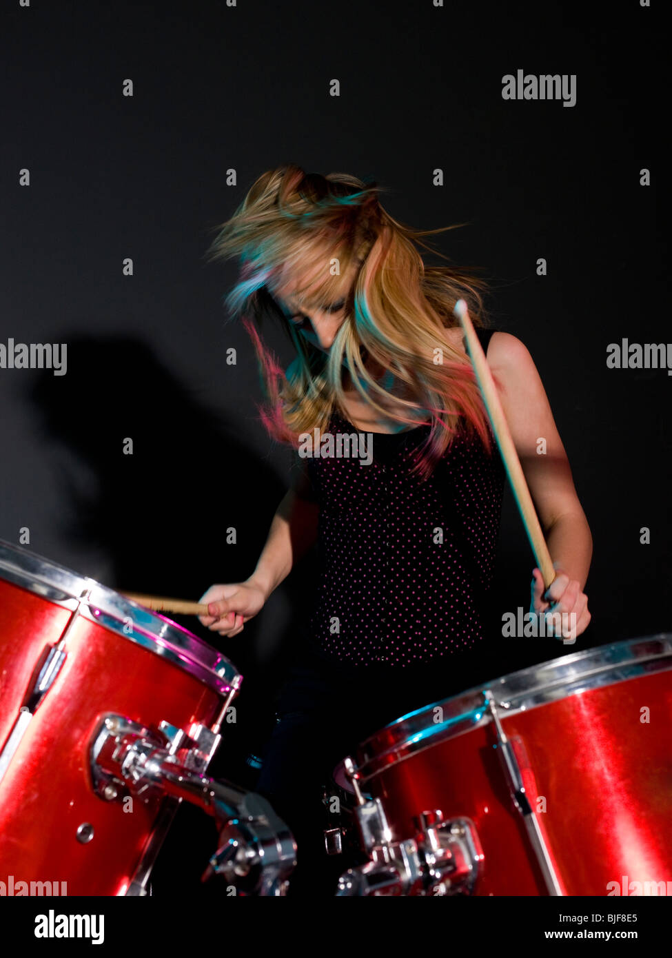 rocker girl on the drums - Stock Image
