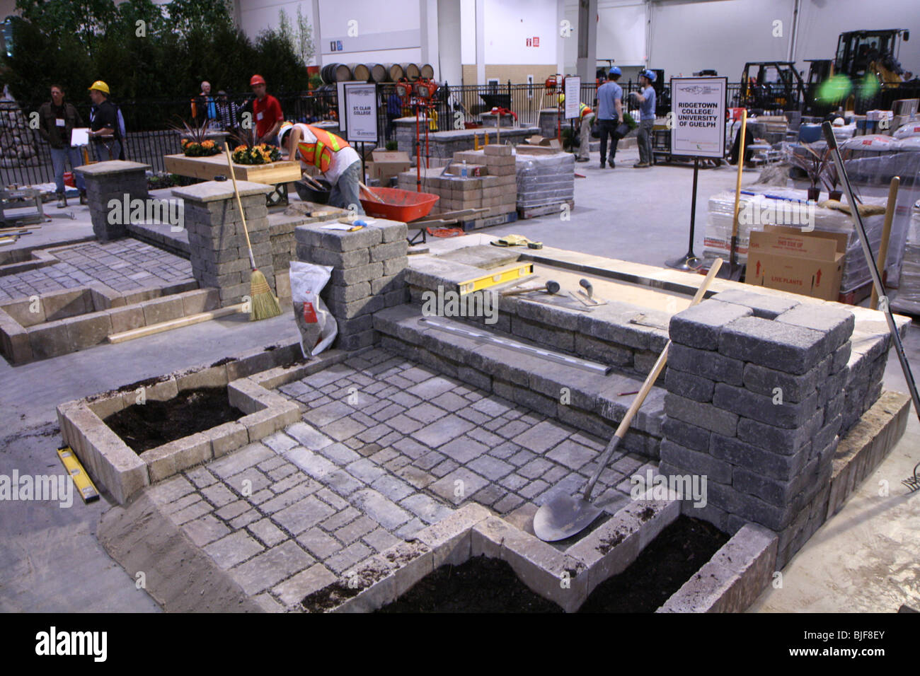 landscape demo students bricks shuffle stone material patio soil competition - Stock Image