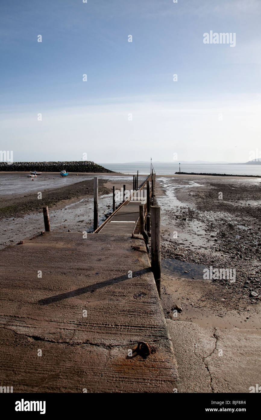 View along slipway and jetty at low tide at Rhos on Sea, North Wales - Stock Image
