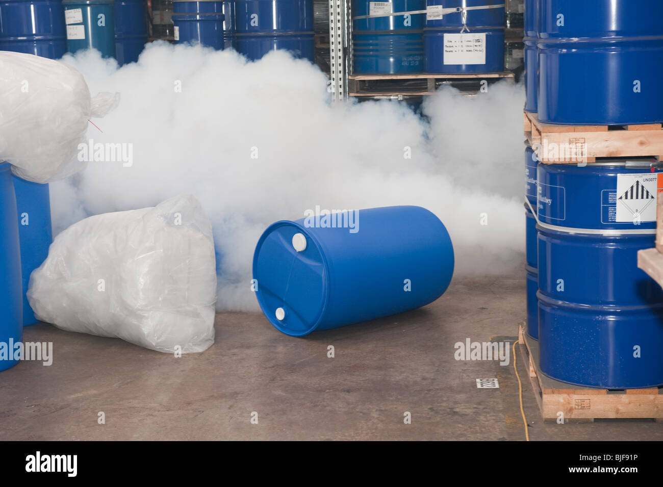 Chemical drum spillage and poisonous gas leak - Stock Image