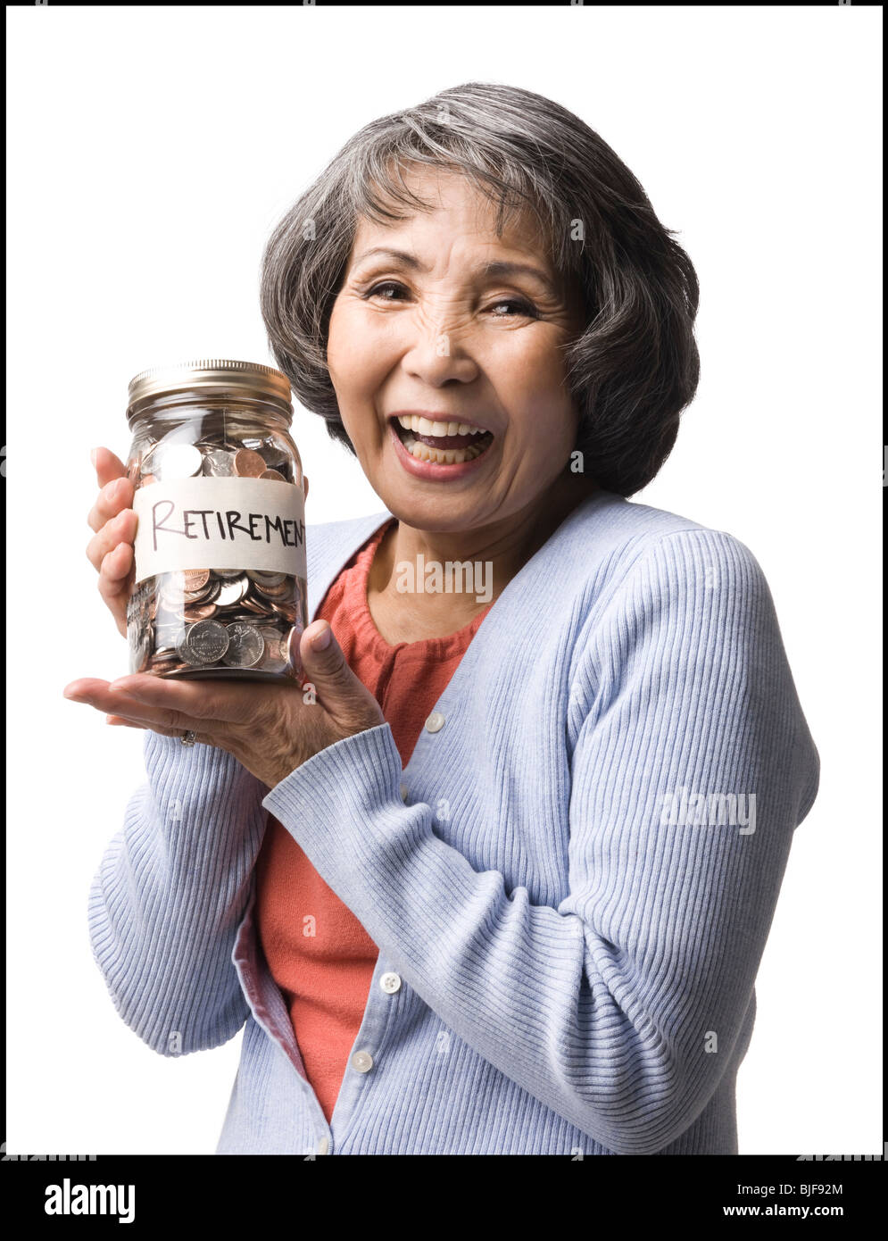woman with a jar full of coins - Stock Image