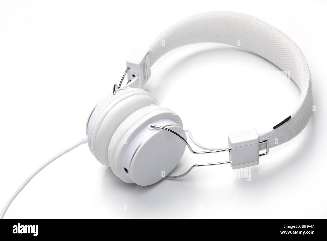 White elegance headfones isolated on white background. White on white series. - Stock Image