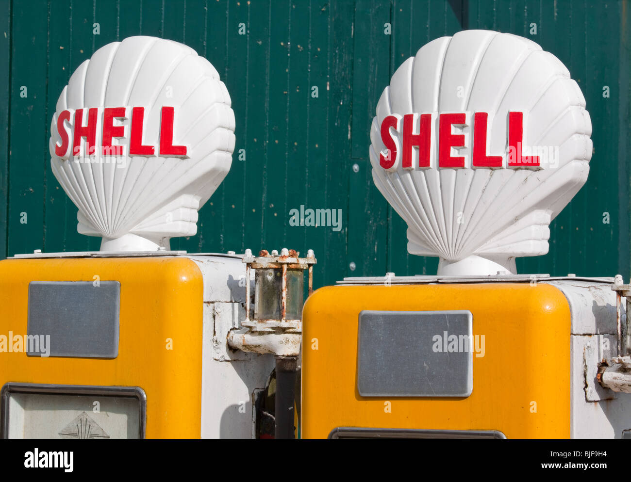 Old Fashioned Shell Petrol Pumps - Stock Image