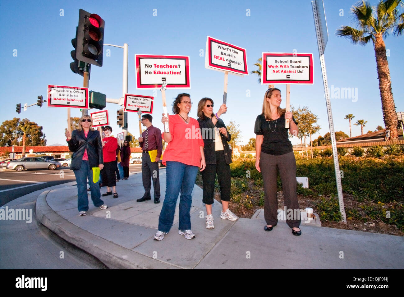 Teachers stage a street corner picket against a threatened pay cut by the city school board Mission Viejo, California. Stock Photo
