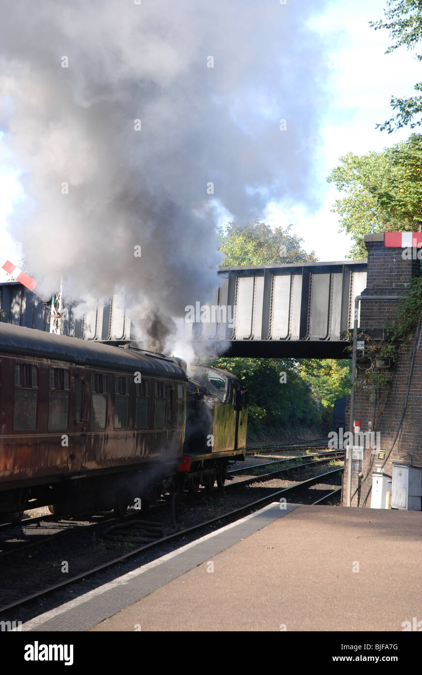 A tank engine pulls away from Sheringham Station on the North Norfolk Railway, UK - Stock Image