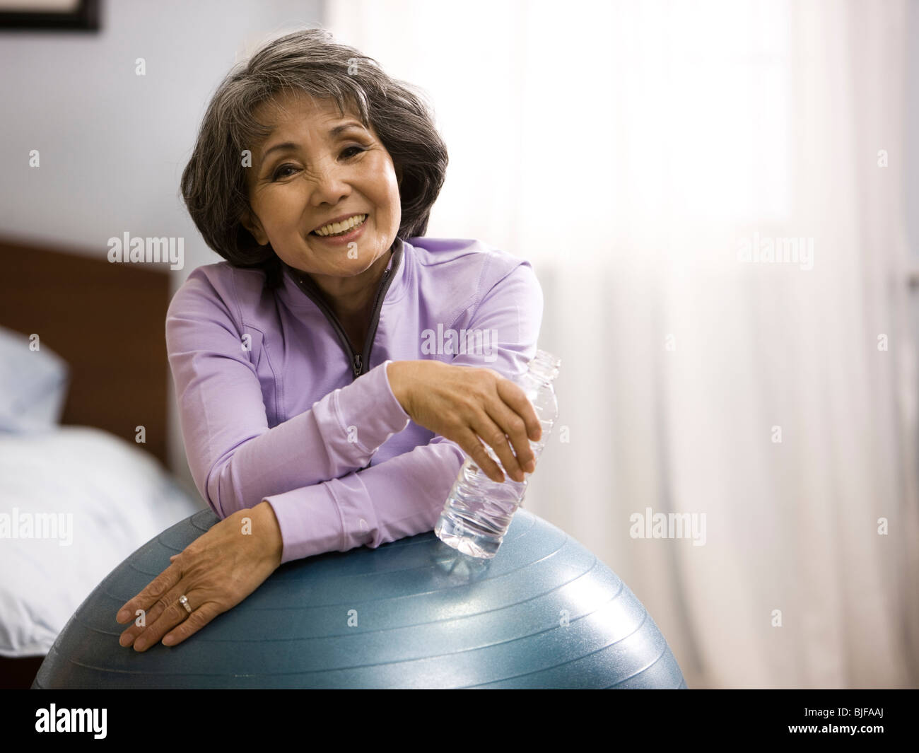 senior woman working out - Stock Image