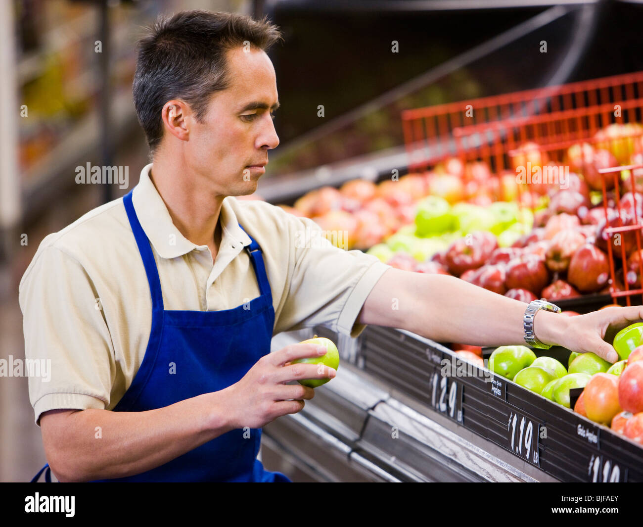 grocery clerk - Stock Image