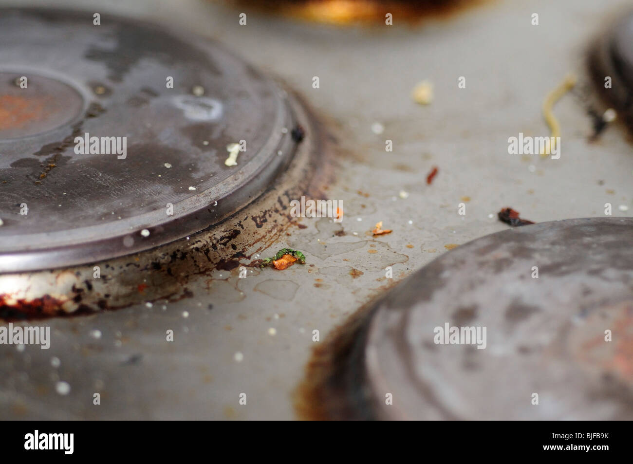 dirty electric Ceramic cooker hob - Stock Image