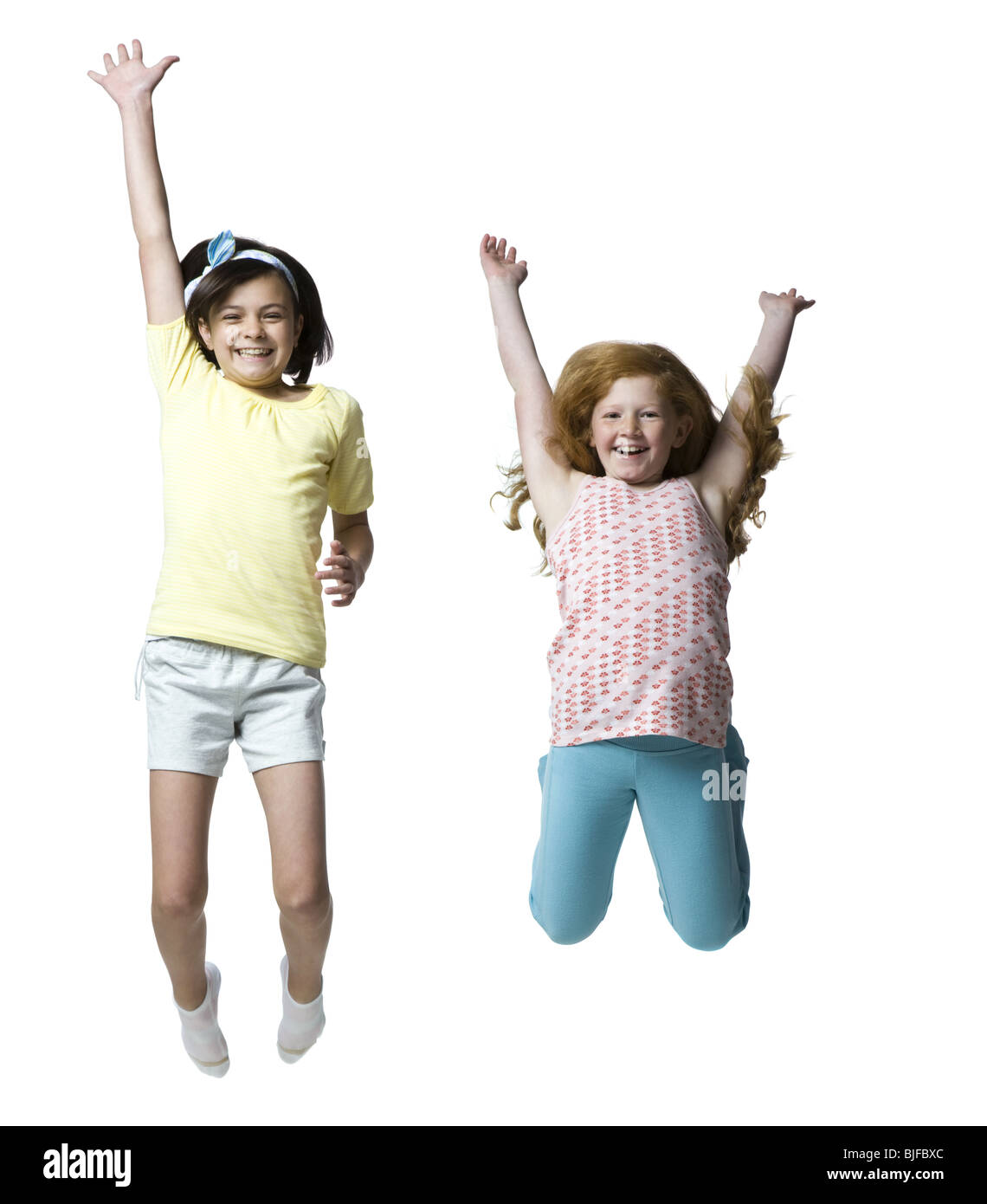 two girls jumping - Stock Image
