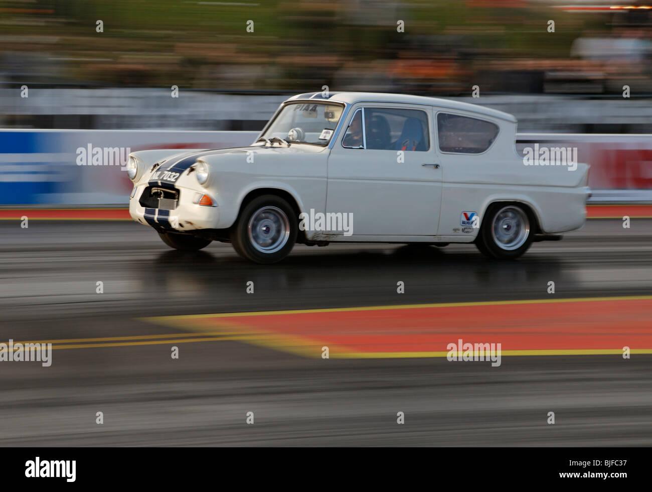 Old Ford Anglia racing at Santa Pod. - Stock Image