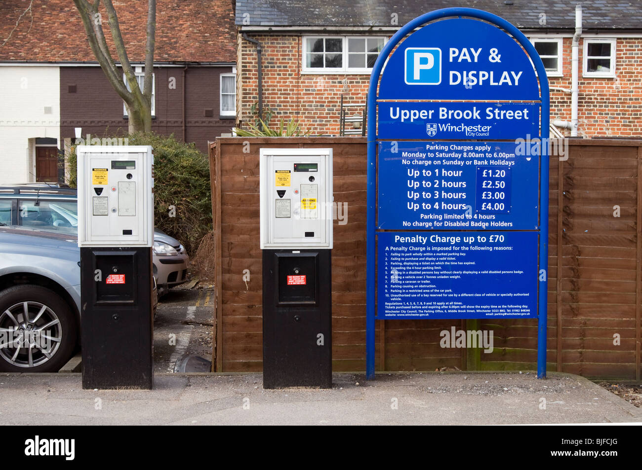 Pay and Display car park sign and ticket machines, Upper Brook Street car park, Winchester, Hampshire - Stock Image