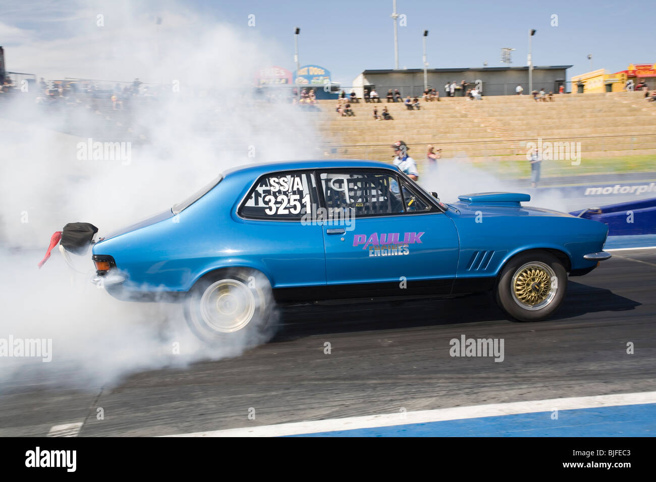 Iconic Australian Holden Torana drag car performing a tyre smoking burnout - Stock Image