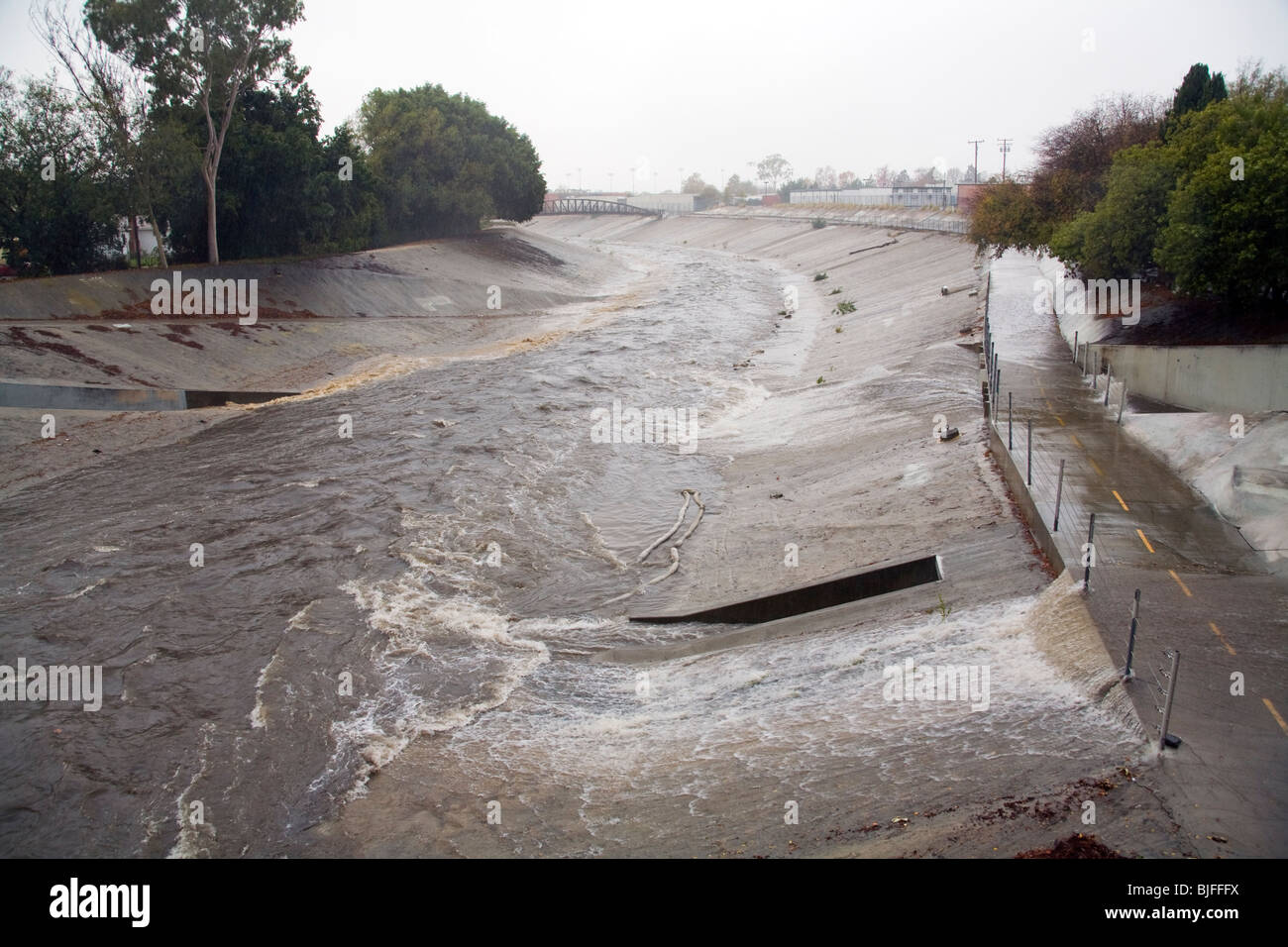 Rain water empties from Storm Pipes into Ballona Creek, a nine-mile waterway that drains the Los Angeles basin. - Stock Image