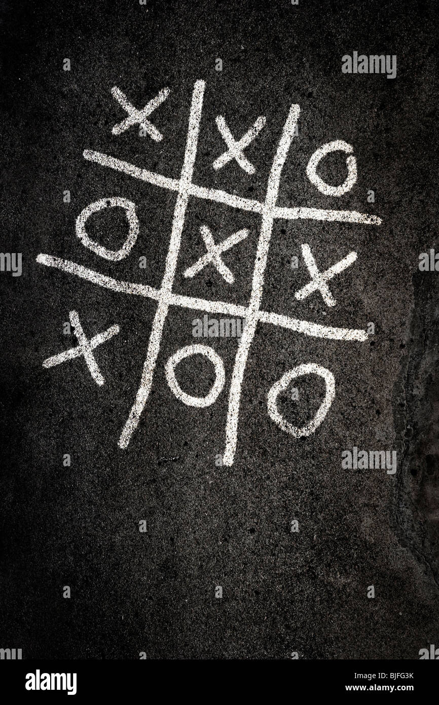 Naughts and Crosses game on paving - Stock Image