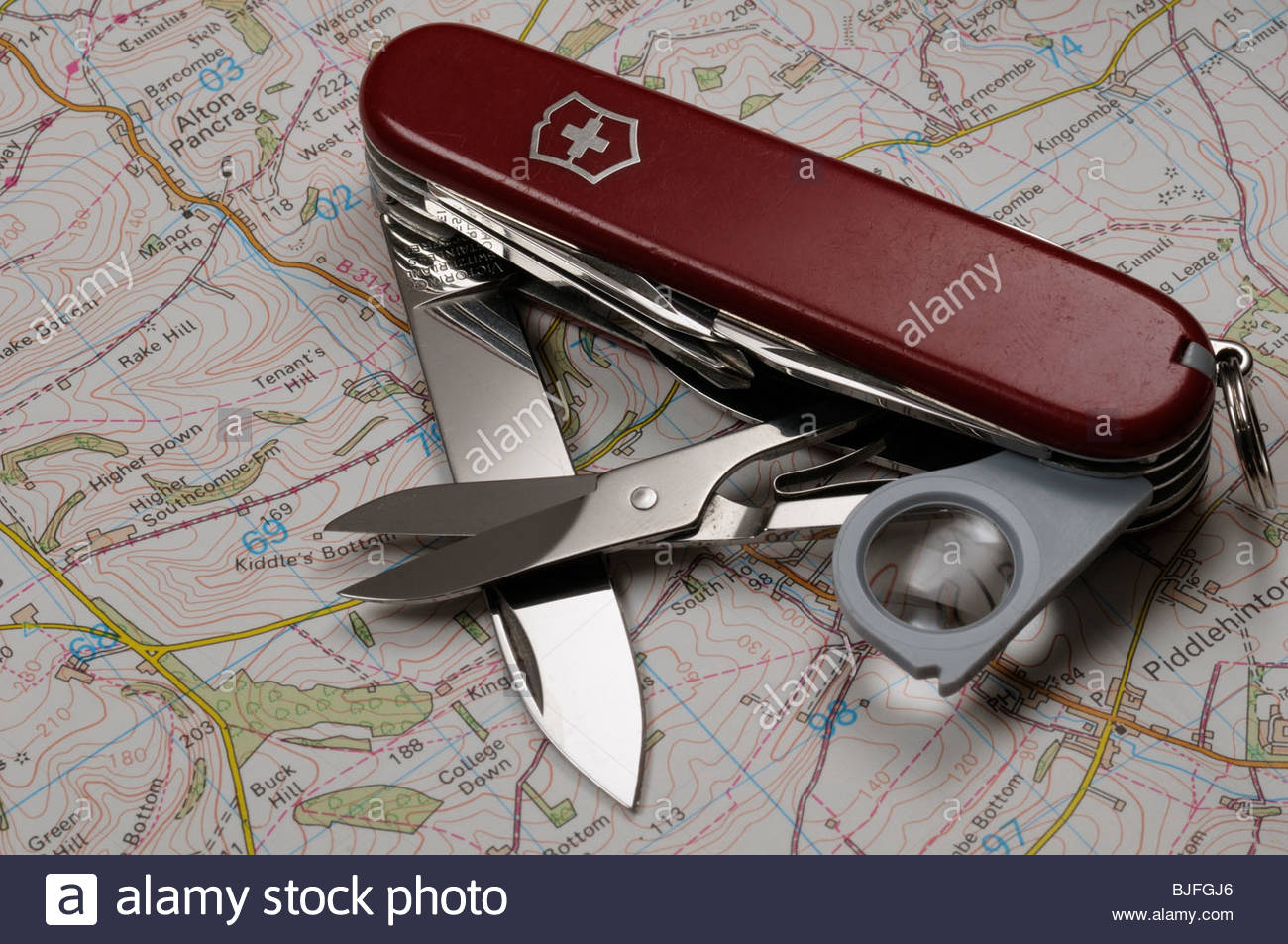 Open Swiss Army knife on map, Dorset, England - Stock Image