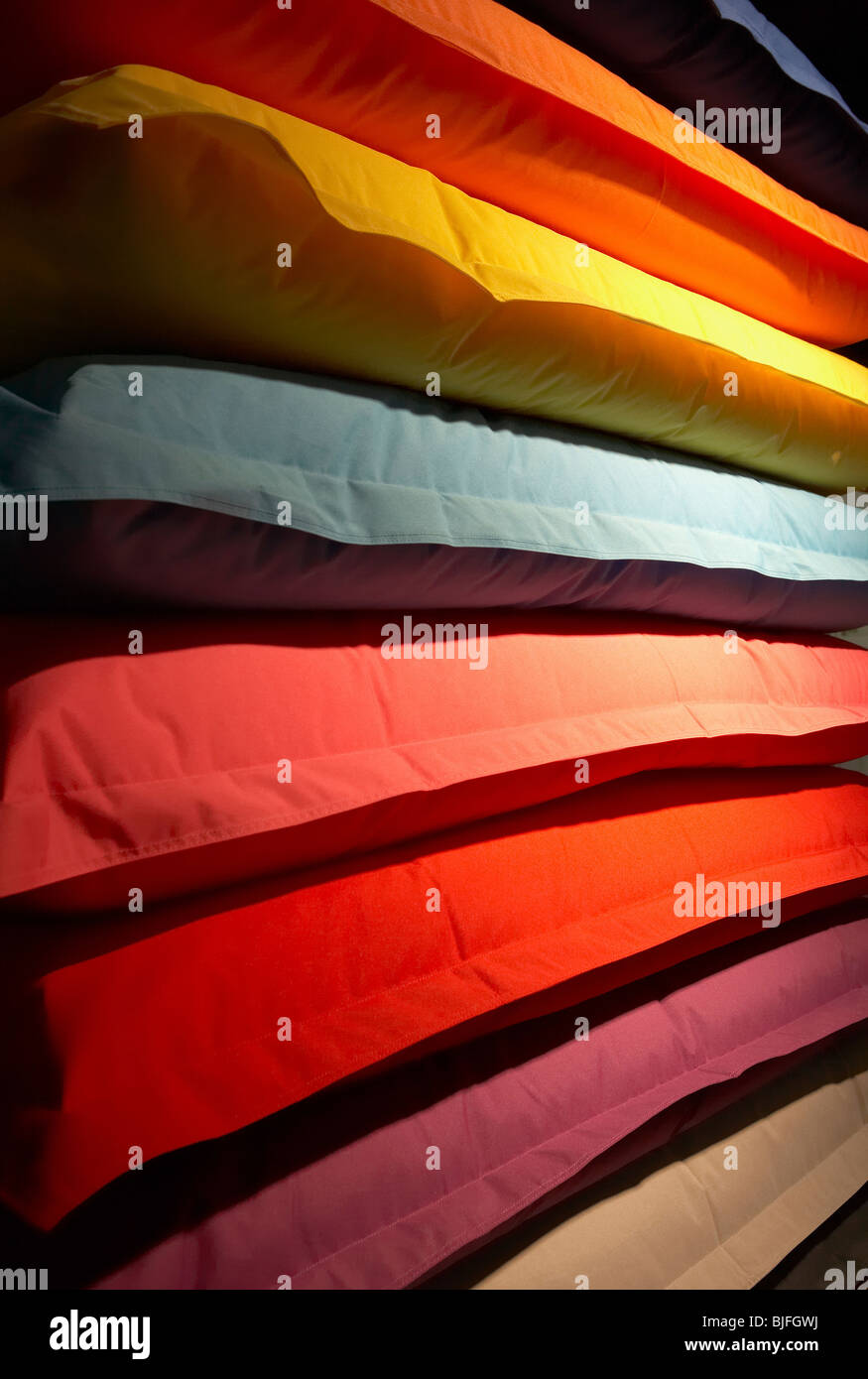 Pile of colorful thick mattresses - Stock Image
