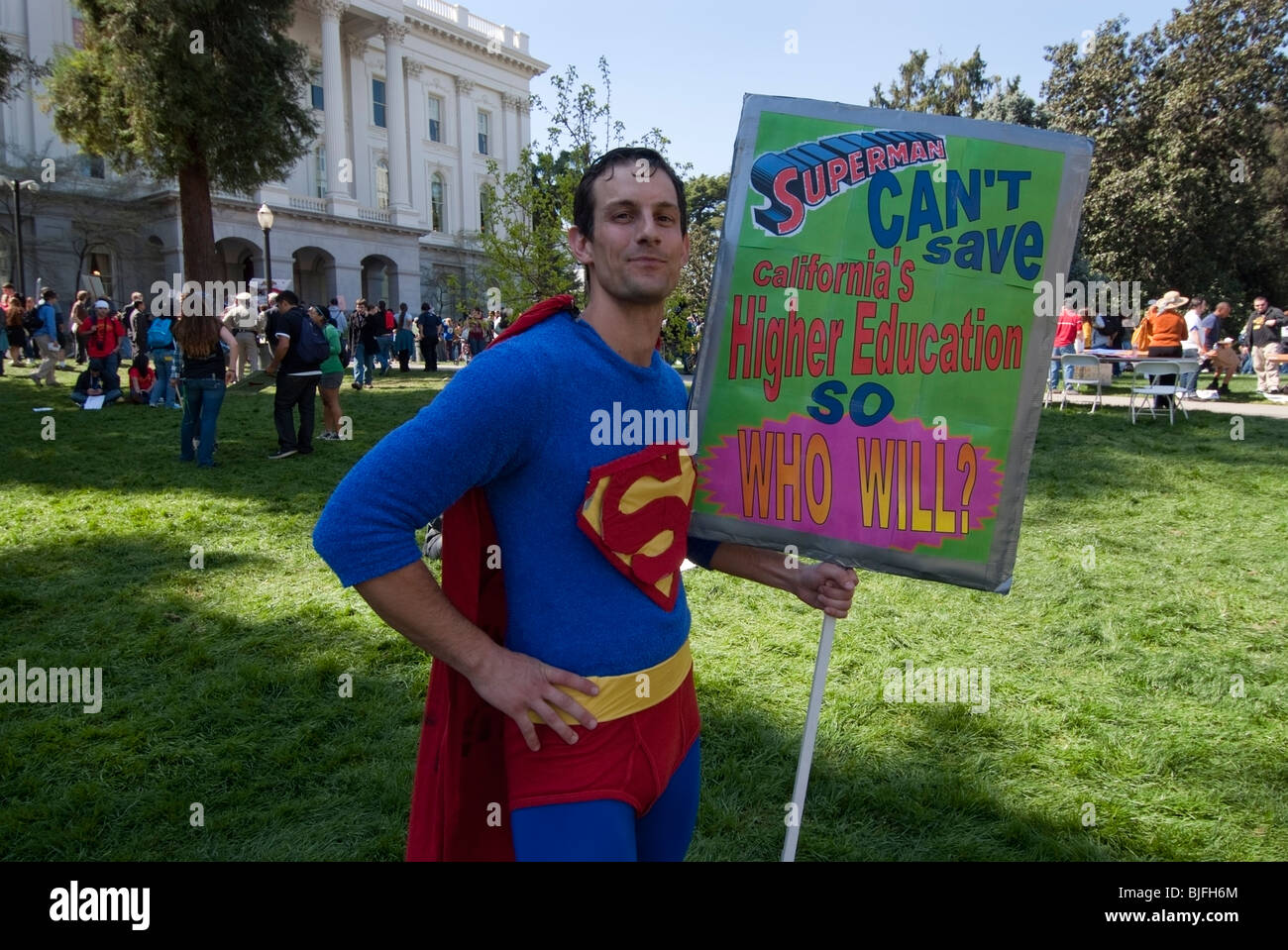 Student dressed as Superman at a demonstration where over 5,000 California students protested budget cuts and higher - Stock Image