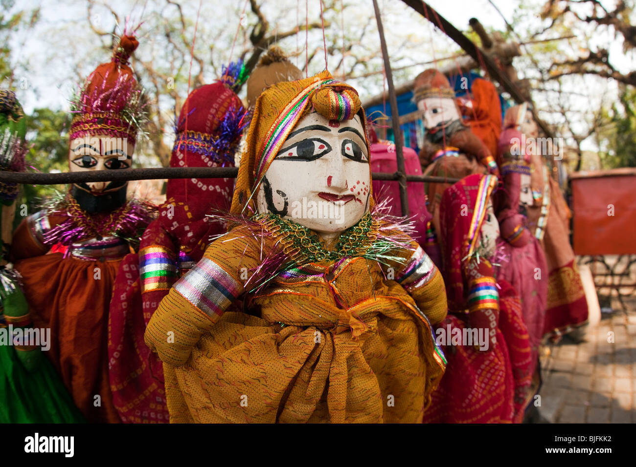 India, Kerala, Kochi, Fort Cochin, inexpensive souvenir puppets displayed for sale - Stock Image