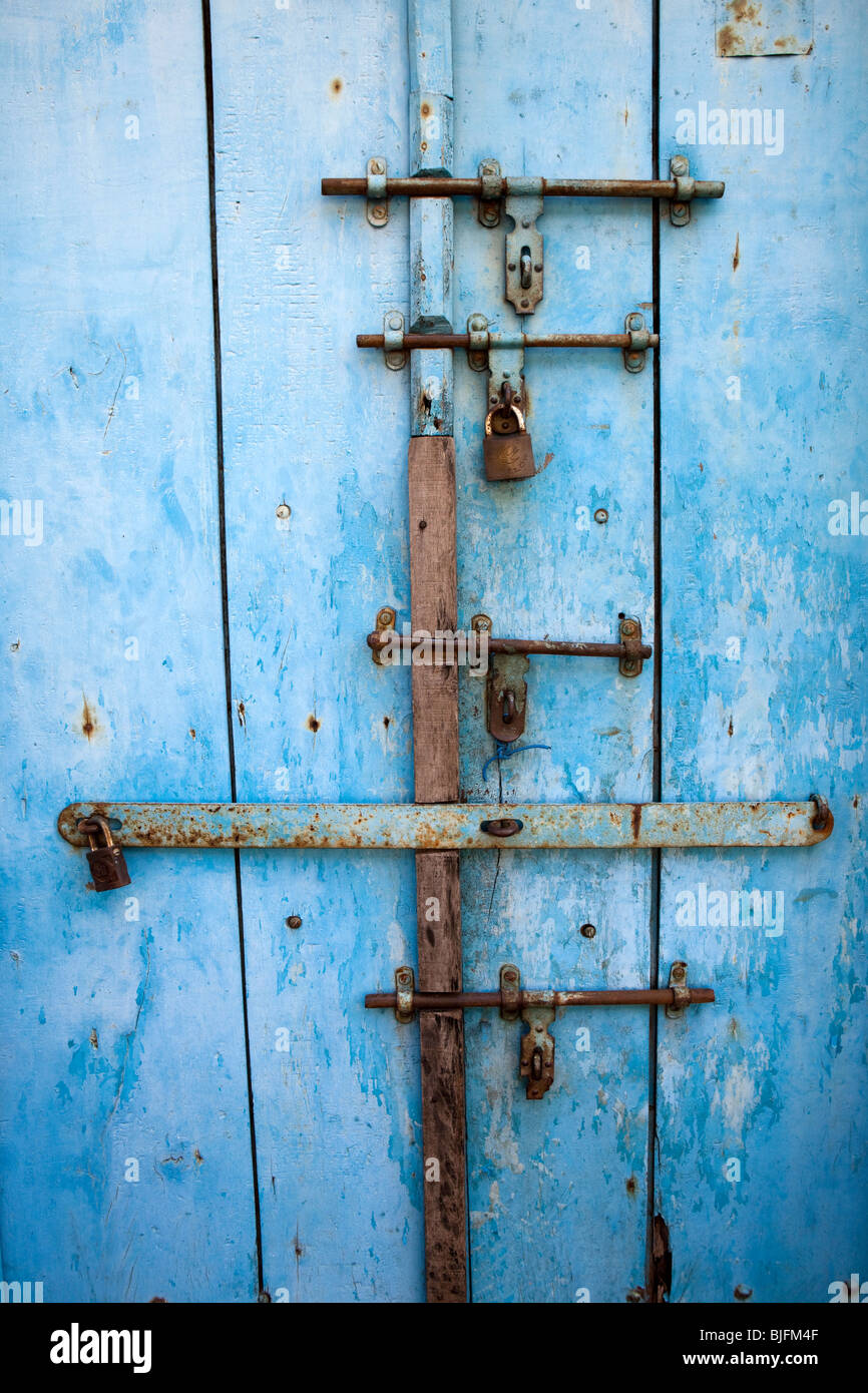 India, Kerala, Kochi, Mattancherry, Jewtown, home security, door secured by five bolts, hasps and staples - Stock Image