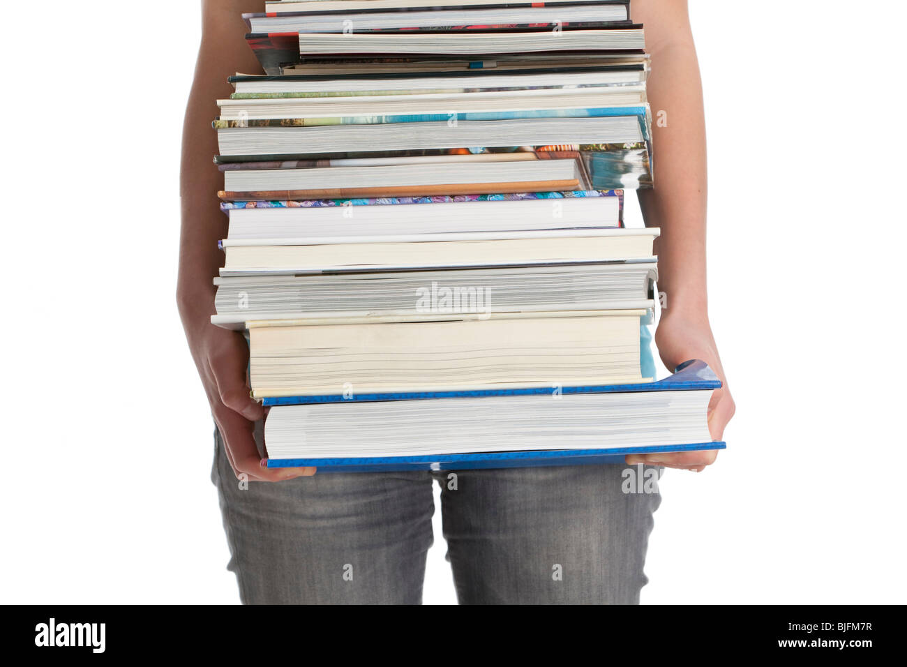 Carrying a pile of heavy books - Stock Image