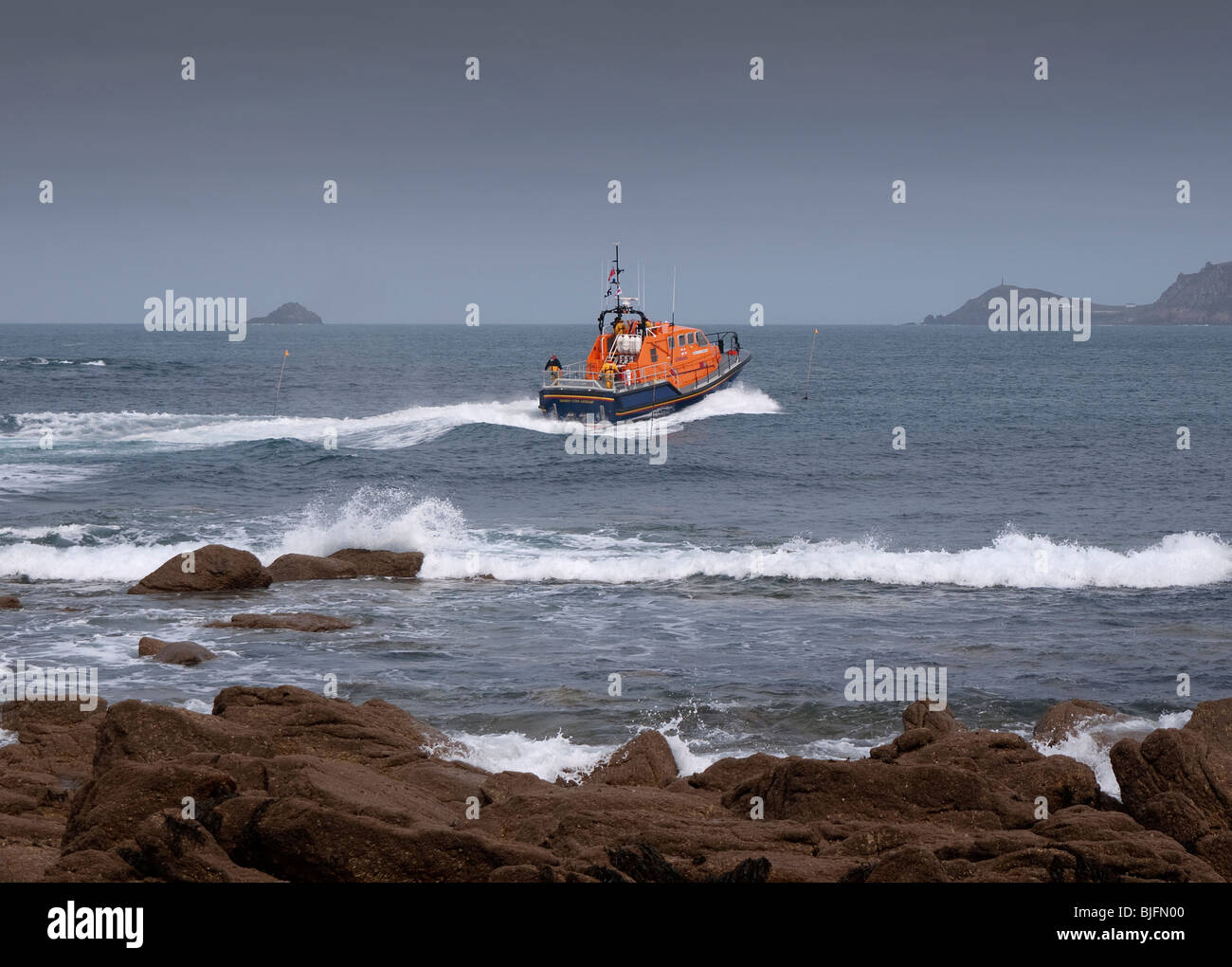 Lifeboat launch at Sennen Cove Cornwall England - Stock Image