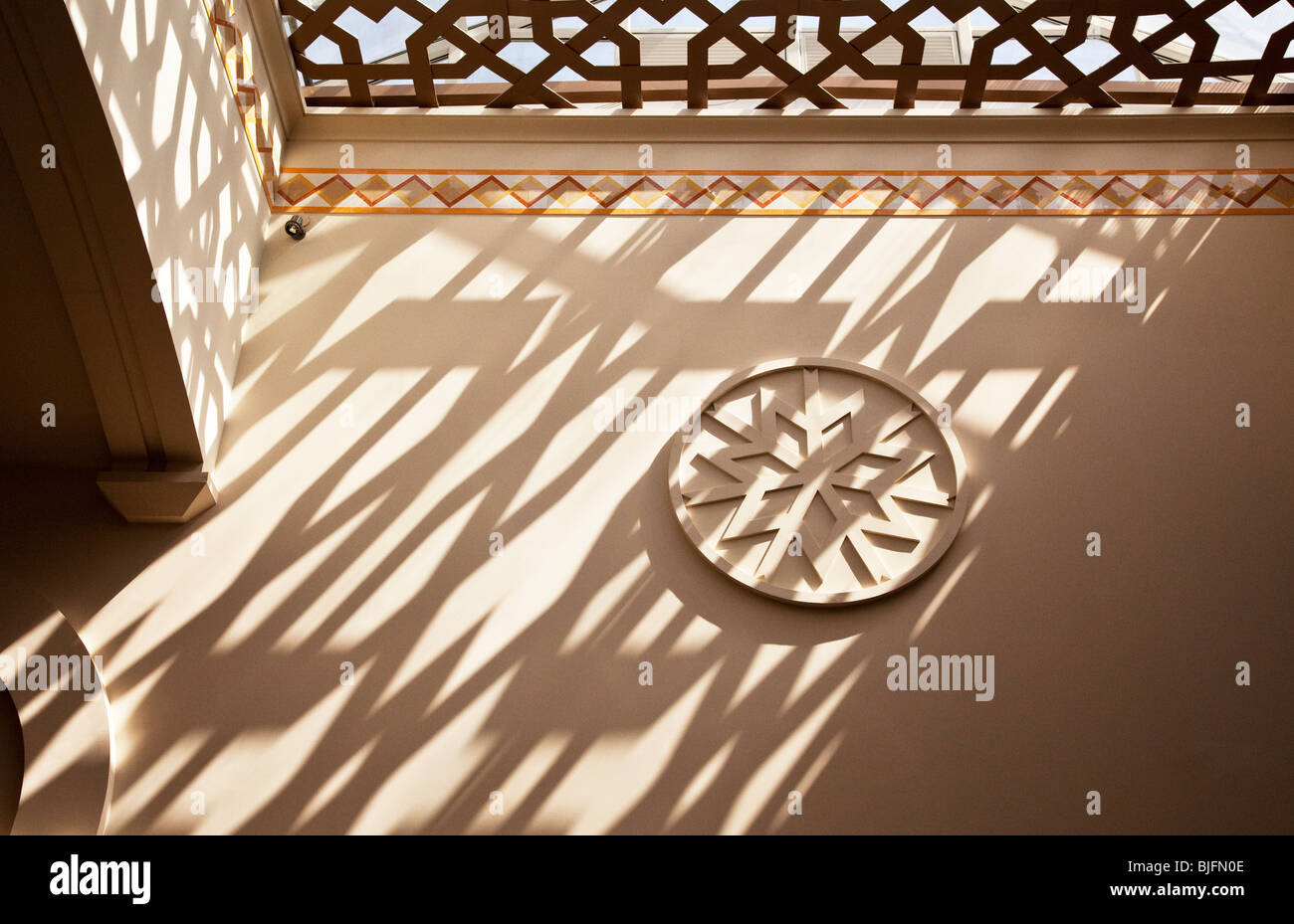 Patterns of light and shadow on a wall inside the Emirates Mall, Dubai, United Arab Emirates, UAE - Stock Image