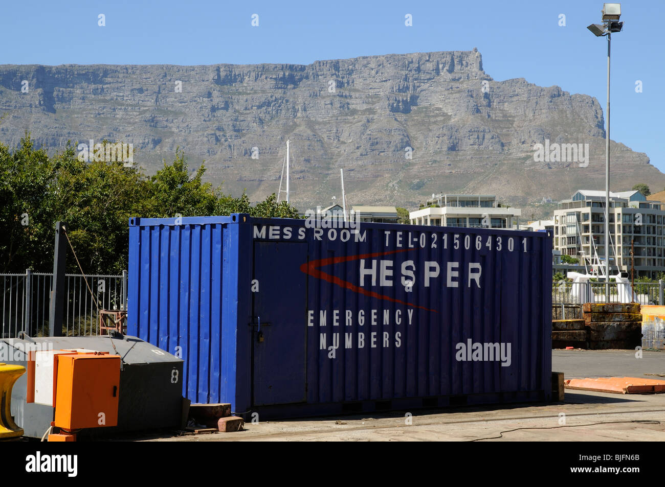 Workers mess room in a secure converted metal container sitting below Table Mountain Cape Town South Africa. Room - Stock Image