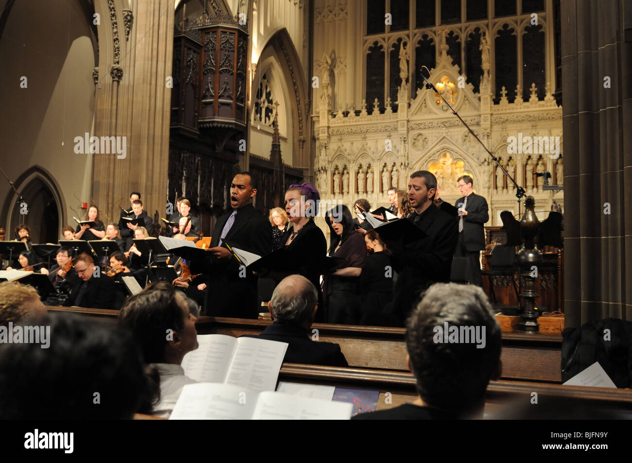 The Trinity Choir and Trinity Baroque Orchestra performing Bach's St. John Passion at Trinity Church in Lower - Stock Image