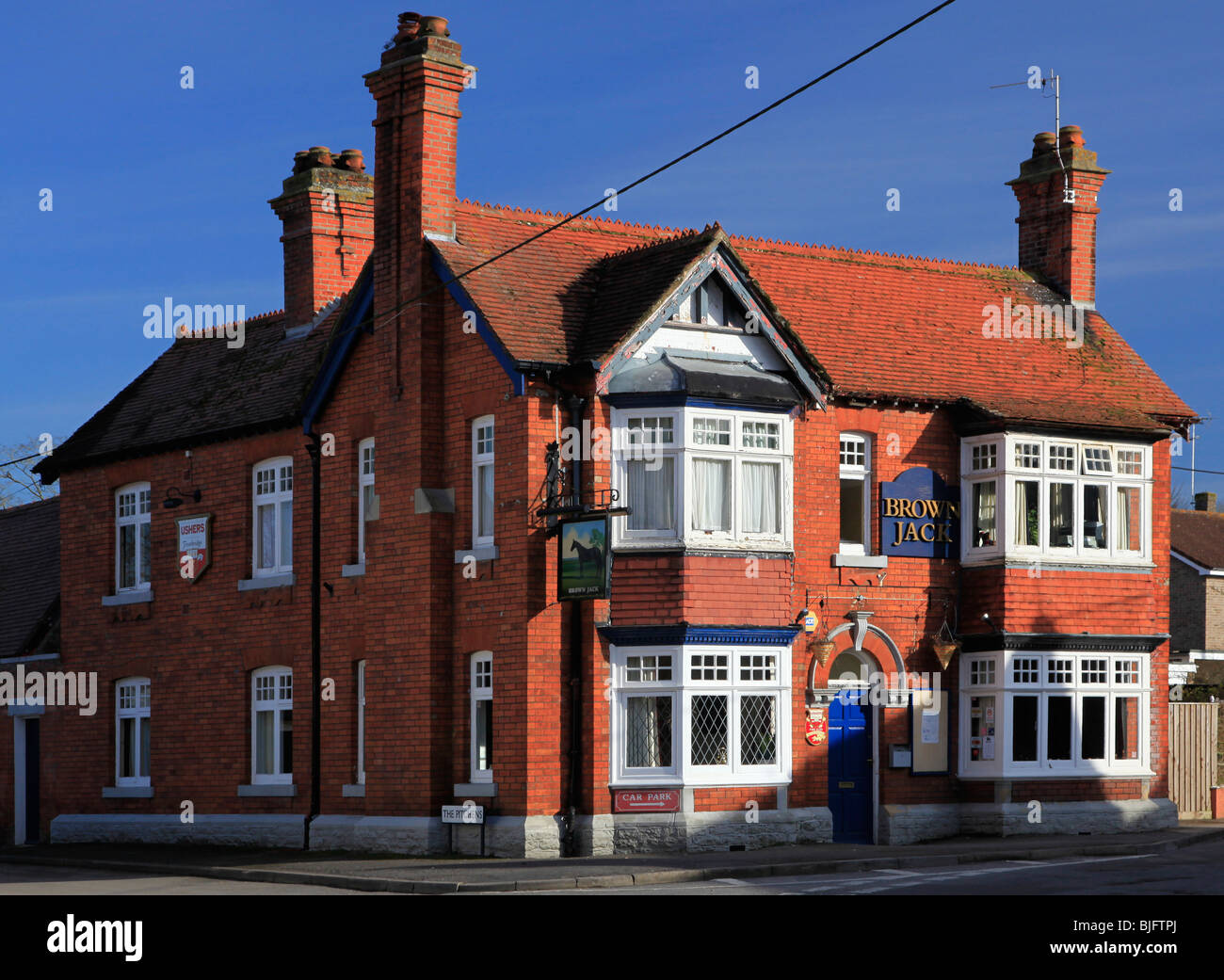 Brown Jack pub a typical Victorian red brick building in the Wiltshire village of Wroughton - Stock Image