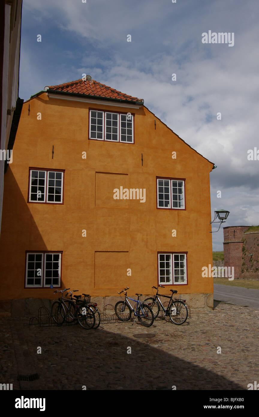 Yellow house near Kronborg castle in Helsingor, Denmark - Stock Image