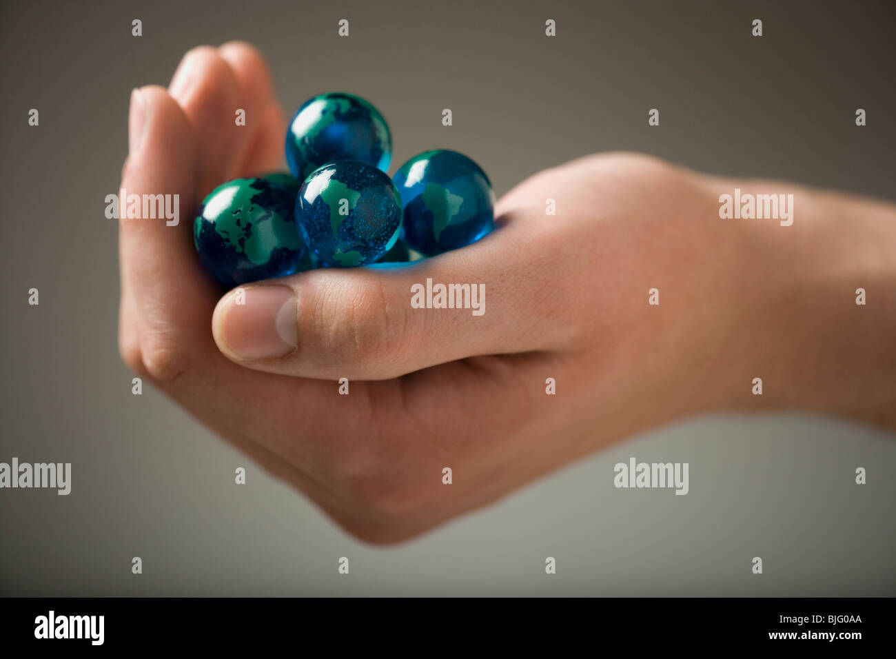 handful of marbles - Stock Image