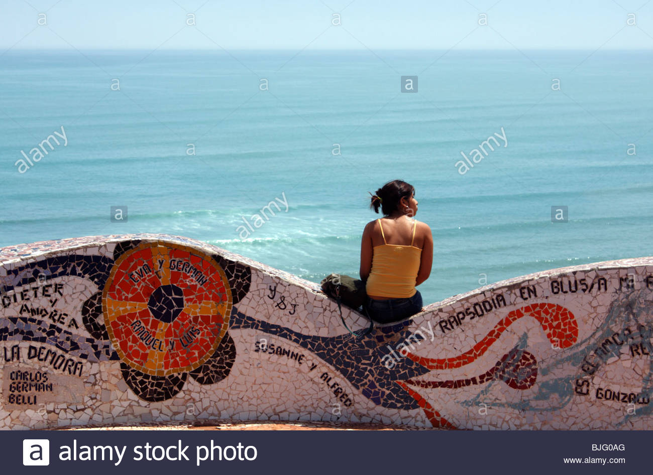 Love-theme mosaic bench at Parque del Amor at Miraflores clifftops, overlooking the Pacific ocean; Lima, Peru - Stock Image