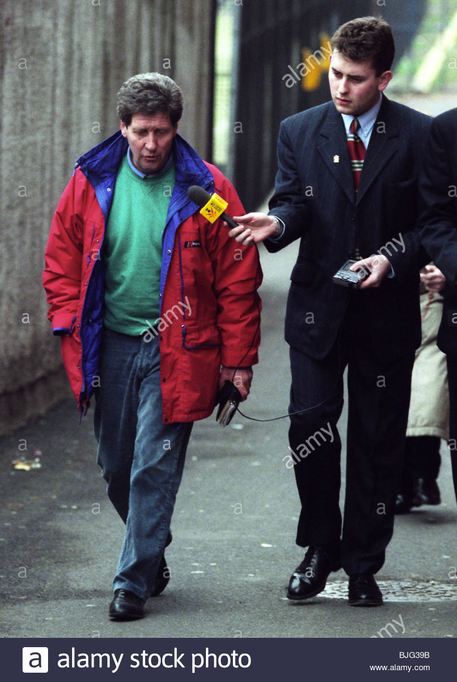 MARCH 1996 FALKIRK Falkirk boss John Lambie (left) is hounded by press as he prepares to resign as manager - Stock Image