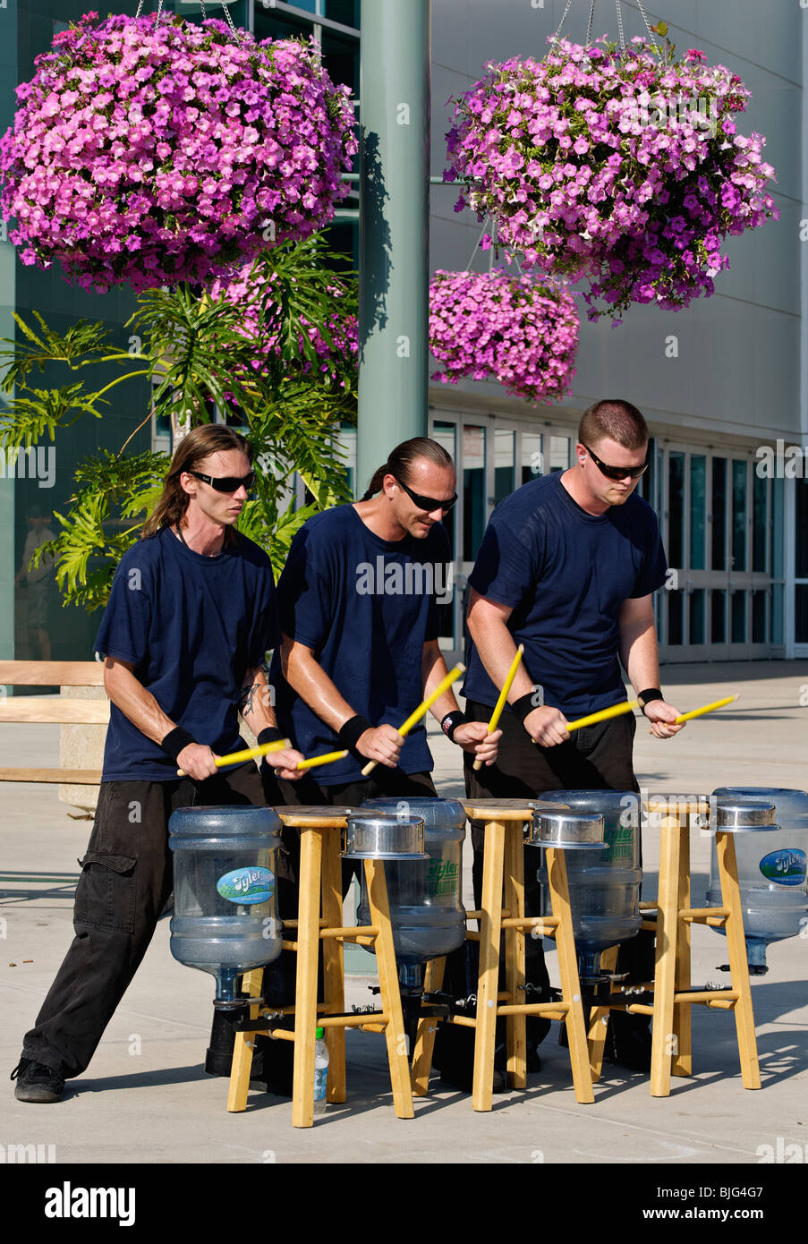 Trio of Synchronized Drummers Playing Empty Water Bottles and Pans at the 2009 Kentucky State Fair in Louisville, - Stock Image