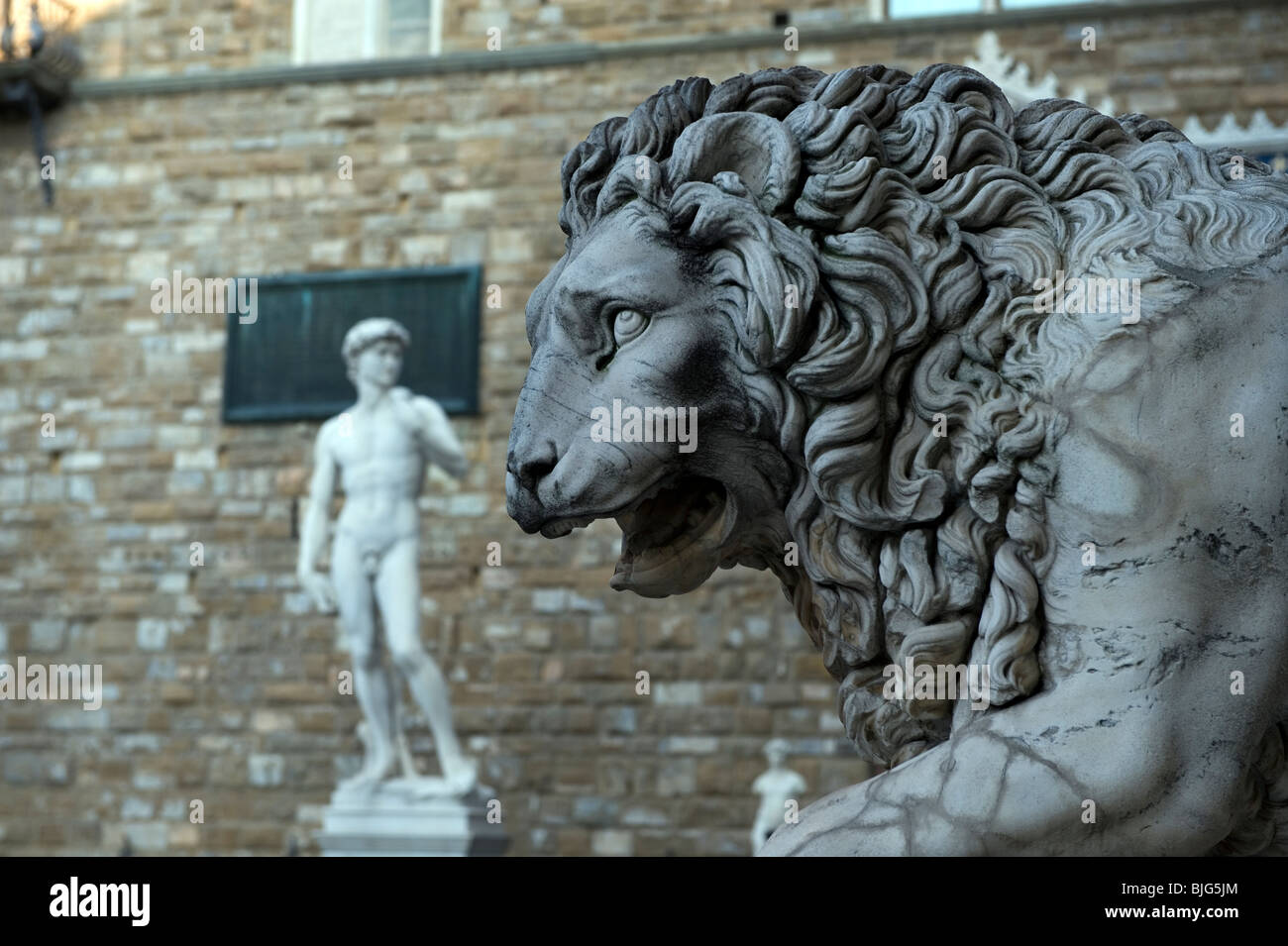 Florence,Tuscany,Italy. Statues of David by Michelangelo ( copy ) on left and the Flaminio Vaca-Lion - Stock Image