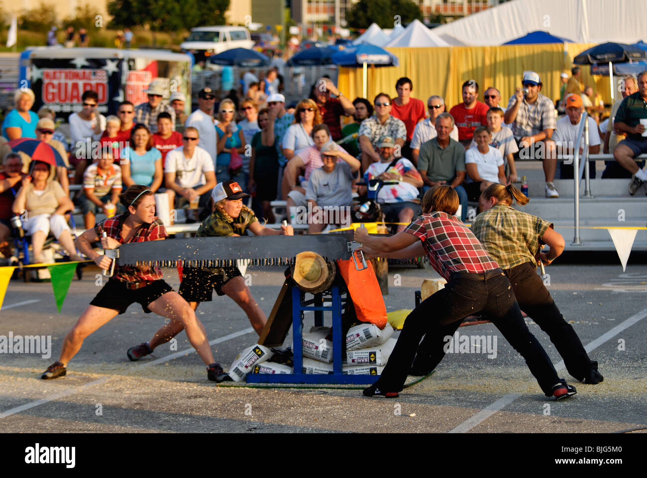 Female Lumberjacks Demonstrating Crosscut Saws at the 2009 Kentucky State Fair in Louisville, Kentucky Stock Photo