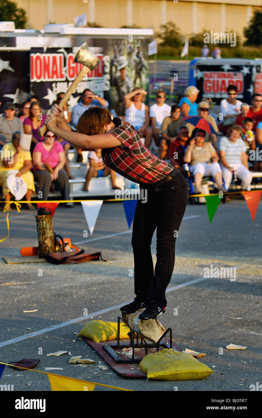 Female Lumberjack Demonstrating the use of an Axe at the 2009 Kentucky State Fair in Louisville, Kentucky - Stock Image