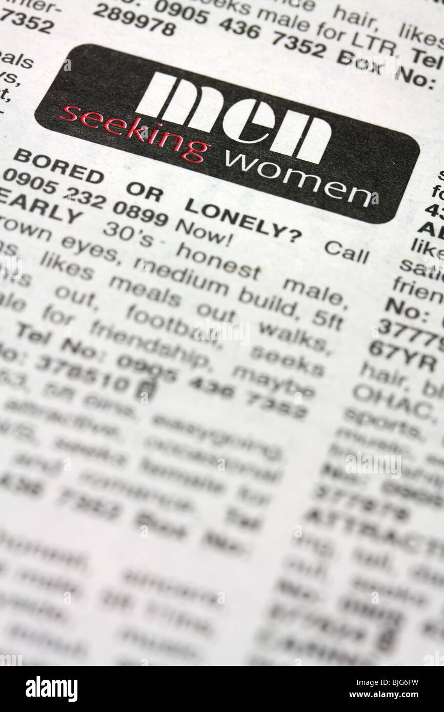 lonely hearts small ads section in newspaper - Stock Image