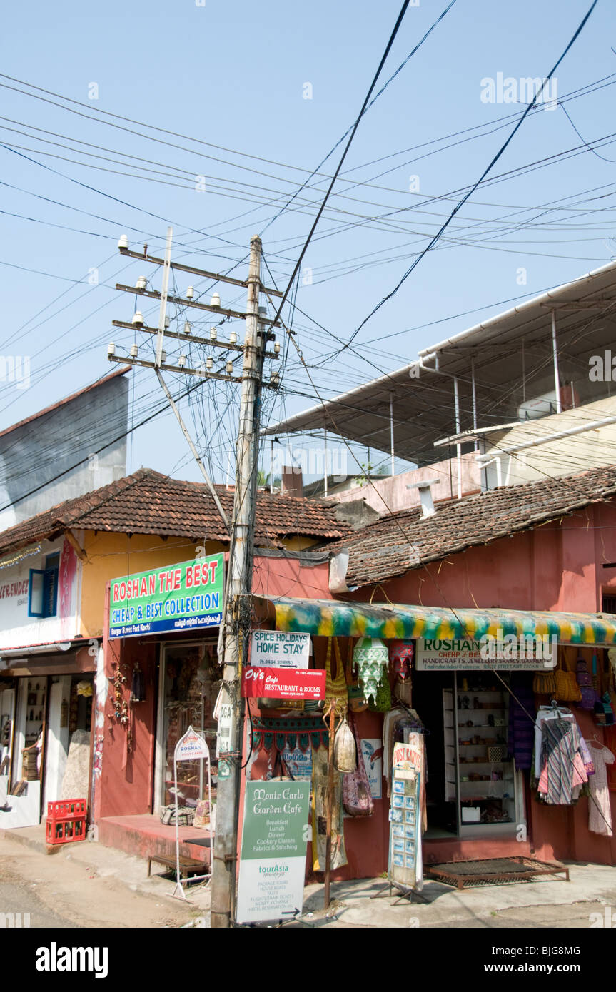 A communication signal pole with a mess of wires at Fort Kochi, Kerala, India - Stock Image