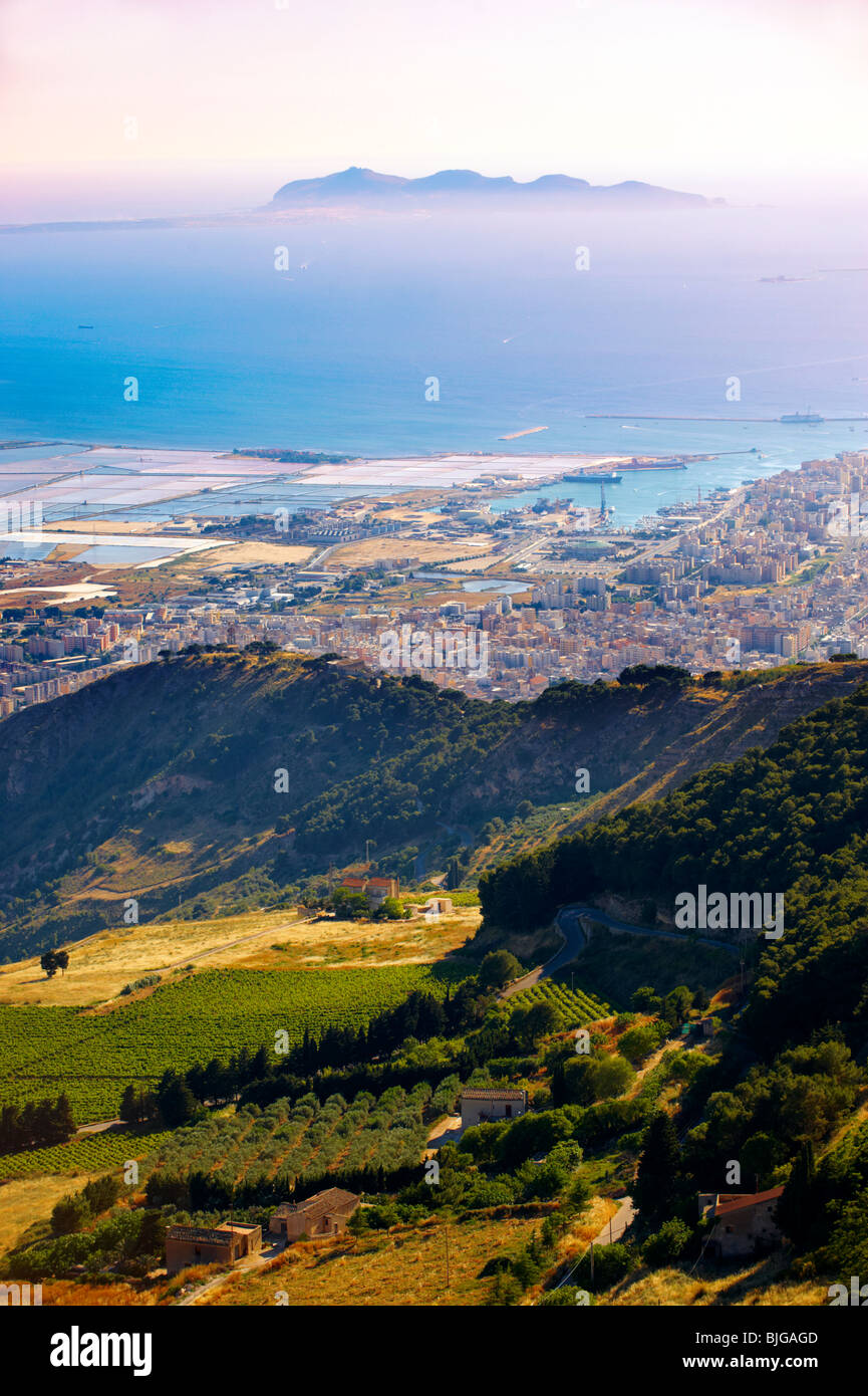 View of Trapani and its salt pans with Favignanana Island in the distance from Érice, Erice, Sicily stock photos. - Stock Image