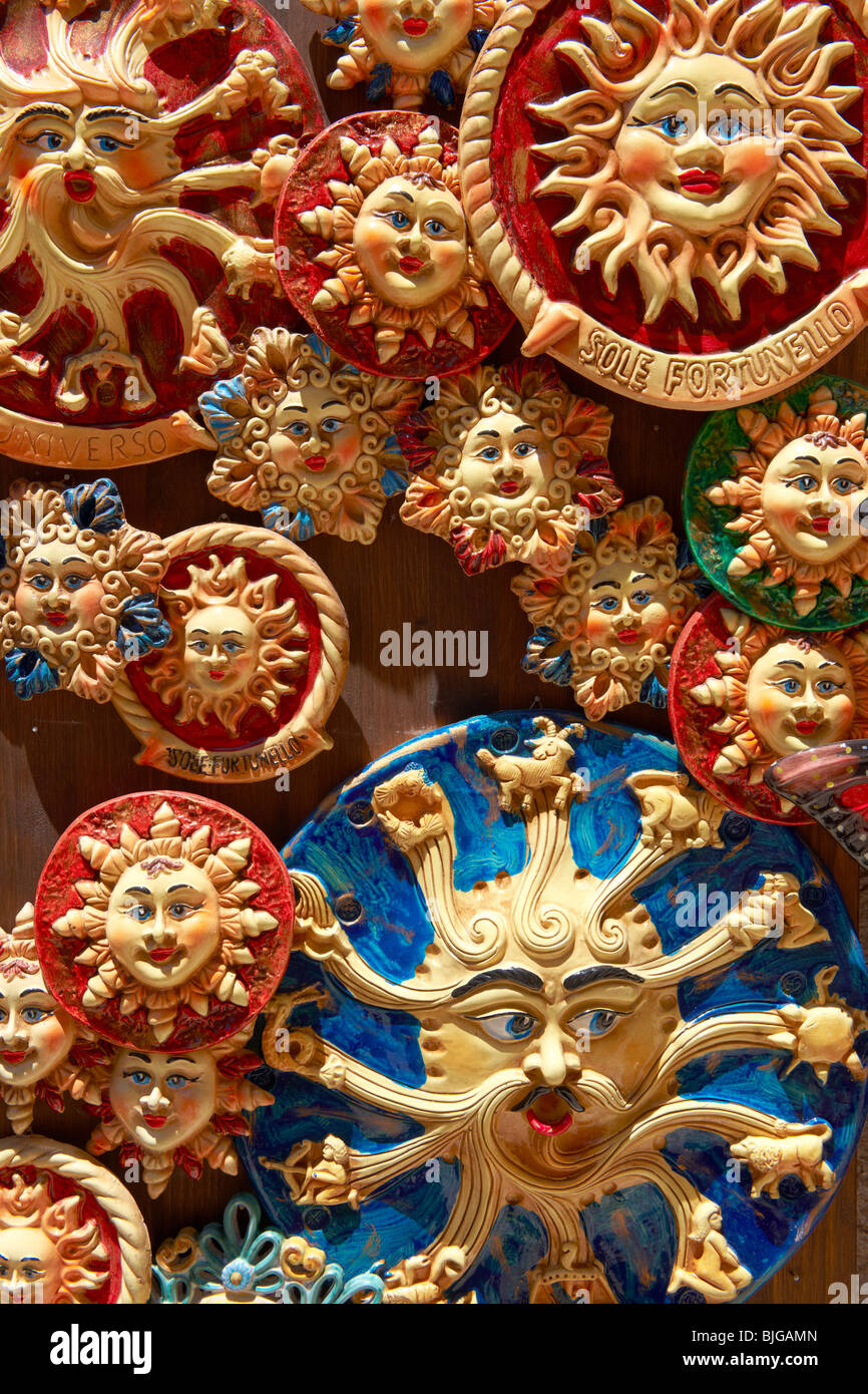 Pottery suns and Trinacria in tourist shops and Sicilian pottery Érice, Erice, Sicily stock photos. - Stock Image