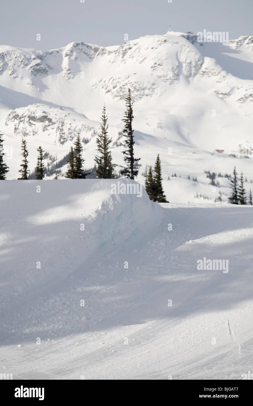 Ski jump in a terrain park. - Stock Image