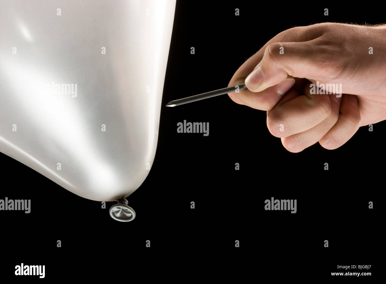 Popping balloon - Stock Image