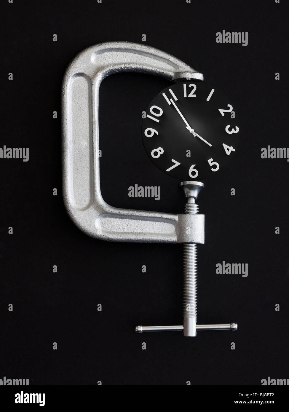 clock in a clamp - Stock Image
