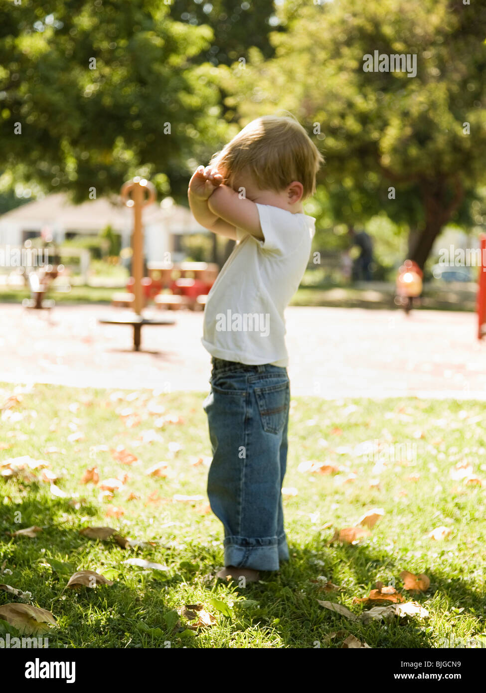 little boy playing hide and go seek Stock Photo