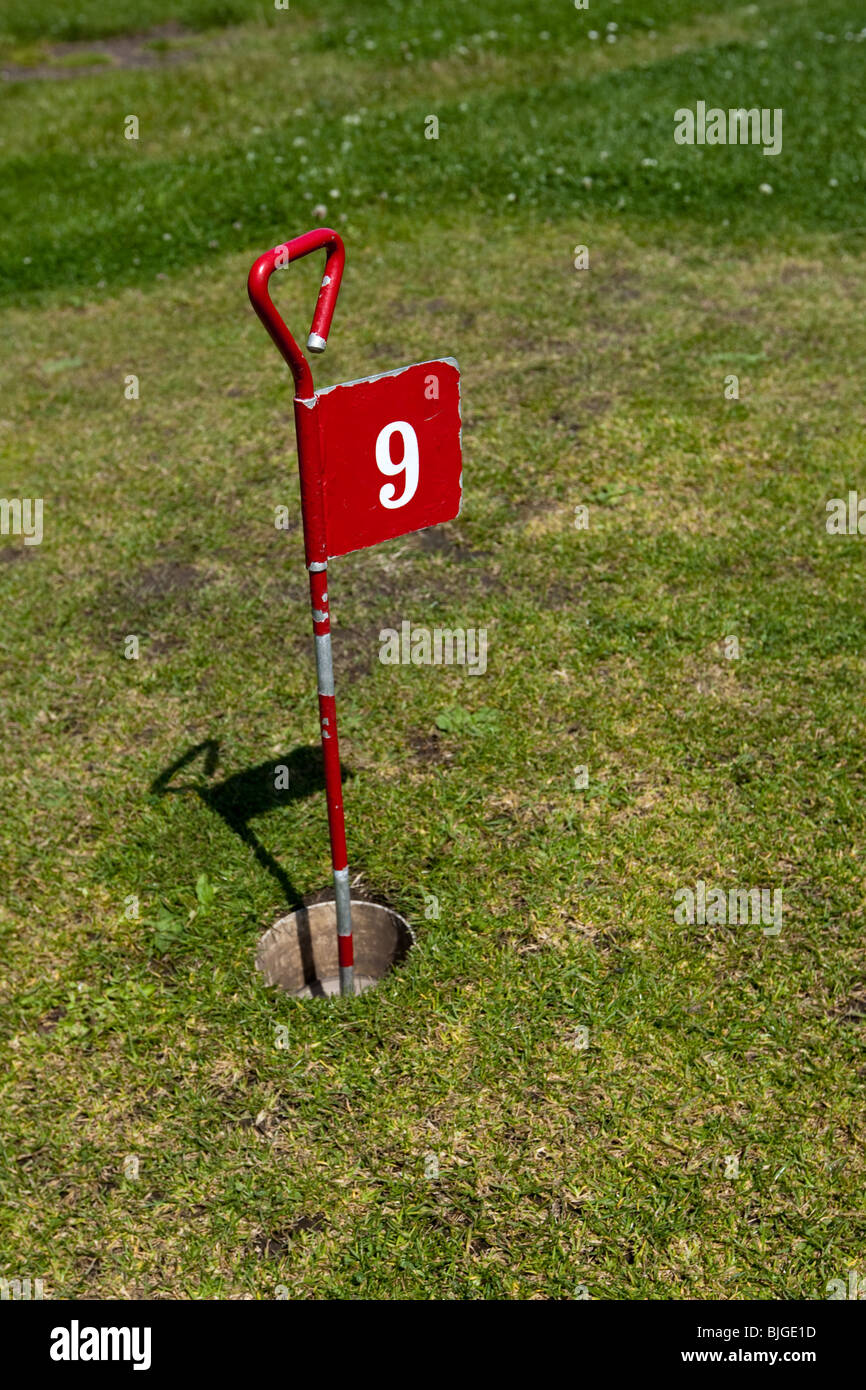 Ninth hole flag on a putting green crazy golf course - Stock Image