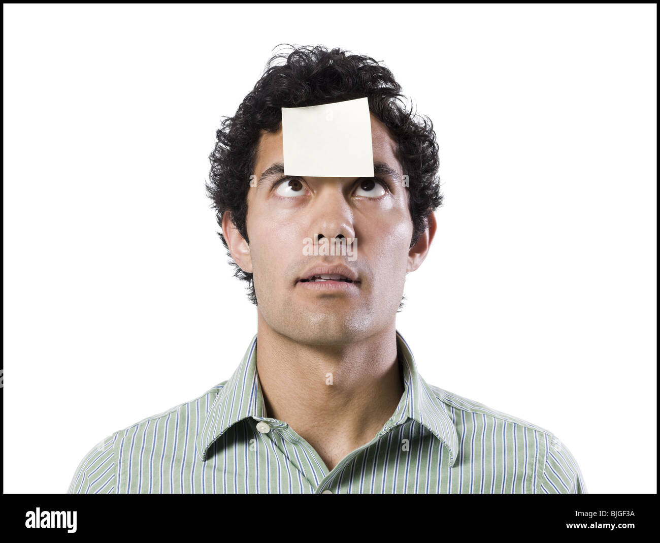 man with a post it note on his forehead - Stock Image