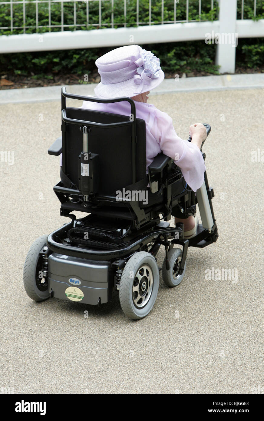 Woman on electric wheelchair at the Royal Ascot horse races, Great Britain - Stock Image